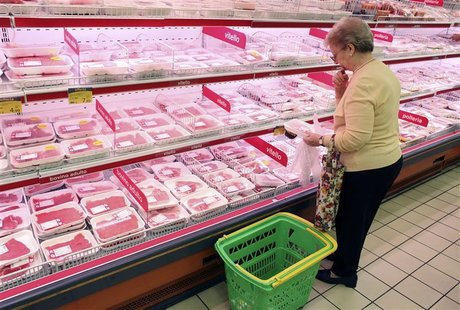 A customer looks browses the meat section at a supermarket in Milan, September 5, 2012. REUTERS/Stefano Rellandini