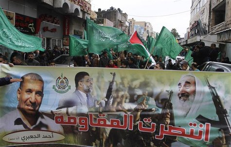 Palestinians wave Hamas flags during a rally celebrating what they claim to be Hamas' victory over Israel in the Gaza conflict, in the West