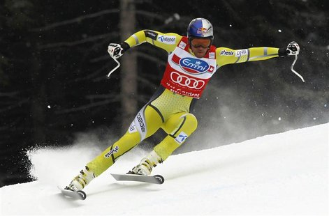 Aksel Lund Svindal of Norway skis past a gate in the men's World Cup Super-G race in Val Gardena, northern Italy, December 14, 2012. REUTERS