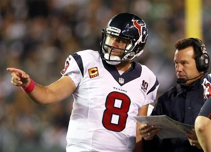 Houston Texans quarterback Matt Schaub talks with Texans head coach Gary Kubiak against the New York Jets during the second half of their NF