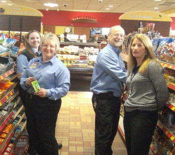 Kwik Trip staff stocking shelves at new Stevens Point Division Street store 12/13/12
