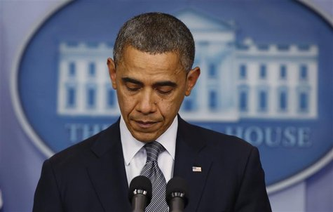 U.S. President Barack Obama pauses as he speaks about the shooting at Sandy Hook Elementary School in Newtown, Connecticut, during a press b