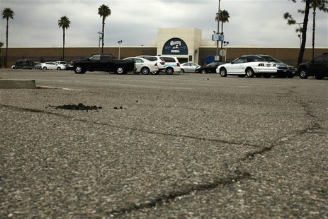 Cracks in the parking lot are seen in front of the Carousel shopping mall in San Bernardino, California September 11, 2012. REUTERS/Lucy Nic