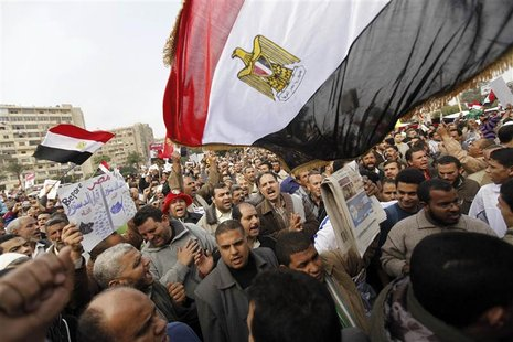 Supporters of Egyptian President Mohamed Mursi and members of the Muslim Brotherhood chant pro-Mursi slogans during a rally in Rabaa El Adaw