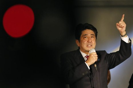 Japan's main opposition Liberal Democratic Party's (LDP) leader and former Prime Minister Shinzo Abe speaks to voters atop a campaign van at