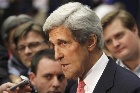 U.S. Senator John Kerry speaks to the media before Republican presidential nominee Mitt Romney and President Barack Obama meet in the final