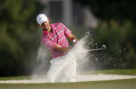 Charl Schwartzel of South Africa hits out of a bunker on the 17th hole during the final round of the DP World Tour Championship at Jumeirah