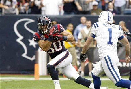 Houston Texans linebacker Bryan Braman scores a touchdown after recovering a blocked punt as Indianapolis Colts punter Pat McAfee tries to c