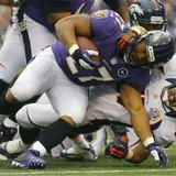 Baltimore Ravens running back Ray Rice (L) is tackled by Denver Broncos linebacker Keith Brooking (R) during the first half of their NFL foo