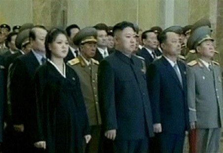 Ri Sul-joo (L), the wife of North Korean leader Kim Jong-un (2nd L), is seen during the inaugural ceremony of the Kumsusan Palace Of The Sun