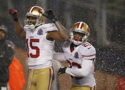 San Francisco 49ers wide receiver Michael Crabtree (L) celebrates his touchdown against the New England Patriots with 49ers team mate LaMich
