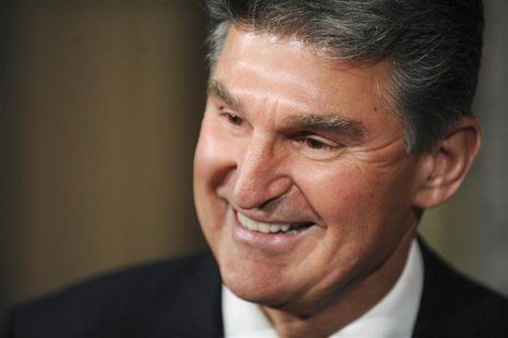 Senator Joe Manchin (D-WV) smiles after being ceremonially sworn in at the US Capitol in Washington, November 15, 2010. REUTERS/Jonathan Ern
