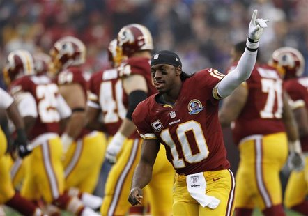 Washington Redskins starting quarterback Robert Griffin III waves to the crowd during pre-game introductions before playing the Baltimore Ra