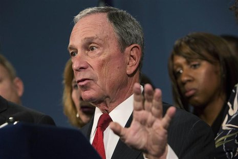 New York City Mayor Michael Bloomberg (C), along with survivors and family members of gun violence victims, addresses the media as part of t