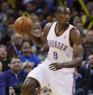 Oklahoma City Thunder forward Serge Ibaka of Congo plays against the San Antonio Spurs during the first half of their NBA basketball game in