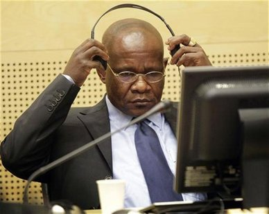 Congolese warlord Mathieu Ngudjolo Chui puts on his headset in the courtroom of the International Criminal Court in The Hague November 24, 2