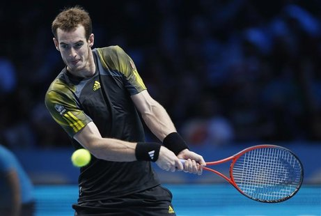 Britain's Andy Murray hits a return to Switzerland's Roger Federer during their men's singles semi-final tennis match at the ATP World Tour