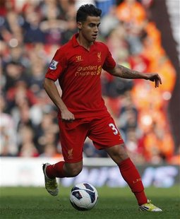 Liverpool's Suso runs with the ball during their English Premier League soccer match against Stoke City at Anfield in Liverpool, northern En