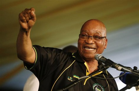 South Africa's President Jacob Zuma celebrates his re-election as Party President at the National Conference of the ruling African National