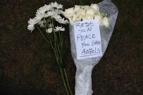 Flowers for the victims of the Sandy Hook Elementary School rest at a memorial in Newtown, Connecticut December 17, 2012. REUTERS/Joshua Lot
