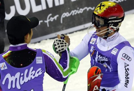 Marcel Hirscher of Austria (R), who won the race, celebrates with Naoki Yuasa of Japan, who placed third, after the men's World Cup slalom r