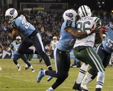 In action that was heard on 1450 WHTC, Tennessee Titans' safety Michael Griffin (33) intercepts a pass in the end zone intended for New York Jets' tight end Jeff Cumberland (86) in the second half of their NFL Monday Night football game in Nashville, Tennessee December 17, 2012. REUTERS/Harrison McClary