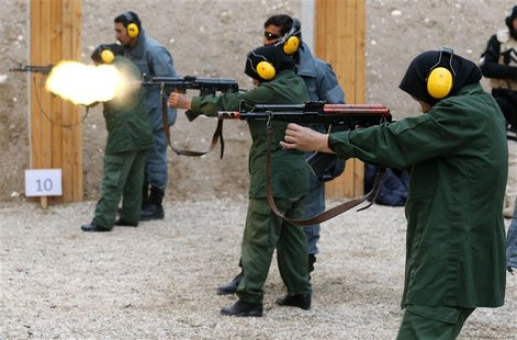 Female Afghan National Police (ANP) trainees fire their weapons at the shooting range at a training centre near the German Bundeswehr army c