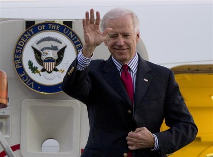 U.S. Vice President Joe Biden waves as he arrives at the Benito Juarez International airport in Mexico City, November 30, 2012. REUTERS/Edua