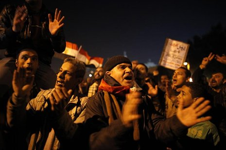 Protesters opposing Egypt's President Mohamed Mursi shout slogans as they demonstrate in front of the presidential palace in Cairo December