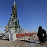 A security guard stands in front of the Soyuz TMA-07M spacecraft set on its launch pad before the blast off with the International Space Sta