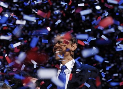 U.S. President Barack Obama celebrates after his victory speech during his election rally in Chicago, in this November 6, 2012 file photo. R