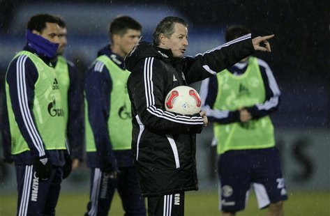 Newly appointed Schalke 04 coach Jens Keller gestures during a practice session of his team in Gelsenkirchen December 17, 2012. REUTERS/Wolf
