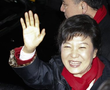 South Korea's presidential candidate Park Geun-hye waves to her supporters as she leaves from the headquarters of the ruling Saenuri party i