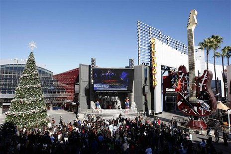 People watch a live broadcast of the memorial service for Mexican-American singer and Spanish language television personality Jenni Rivera a