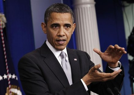 "U.S. President Barack Obama gestures as he speaks to the media about the ""fiscal cliff"" in the White House Briefing Room in Washington Decem"