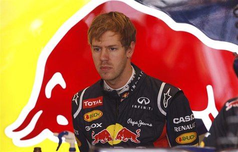 Red Bull Formula One driver Sebastian Vettel of Germany prepares for the second practice session of the U.S. F1 Grand Prix at the Circuit of