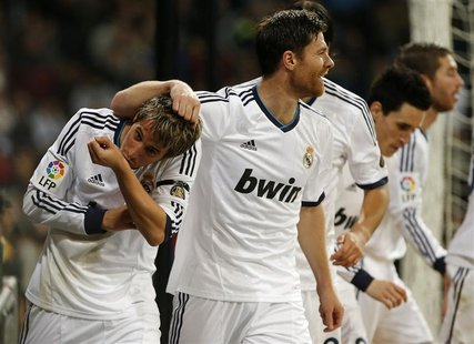 Real Madrid's Fabio Coentrao (L) celebrates his goal with his teammates during their Spanish First Division soccer match against Espanyol at