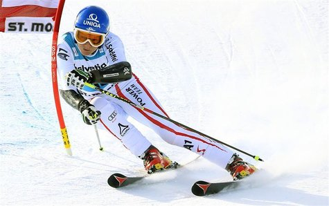 Marlies Schild of Austria clears a gate during the second run of the Giant slalom race at the women's Alpine skiing World Cup at the Corvigl