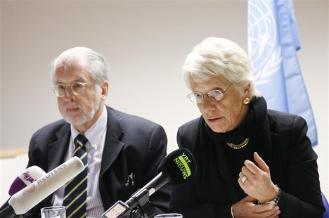Chairman of the United Nations Commission of Inquiry on Syria Paulo Pinheiro and member Carla del Ponte (R) address a joint news conference