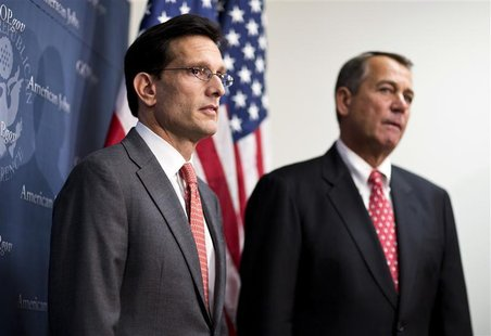 U.S. House Majority Leader Rep. Eric Cantor (R-VA) and House Speaker John Boehner (R)(R-OH) attend a news conference after a Republican cauc