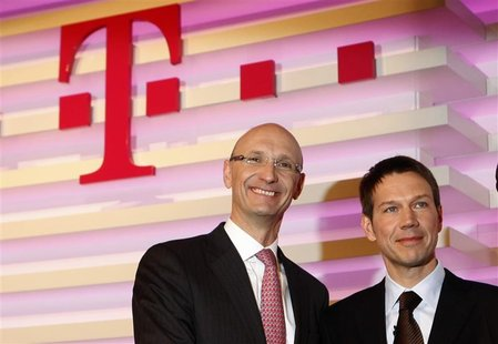 File picture shows designated new finance chief Timotheus Hoettges (L) and Rene Obermann, CEO of Deutsche Telekom AG before the annual news
