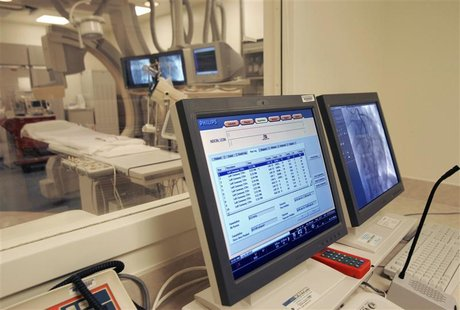 Monitors are seen in a control room at a hospital in New Orleans, February 14, 2006. REUTERS/Lee Celano