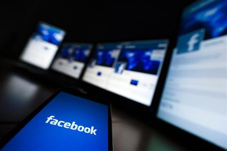 The loading screen of the Facebook application on a mobile phone is seen in this photo illustration taken in Lavigny May 16, 2012.REUTERS/Va