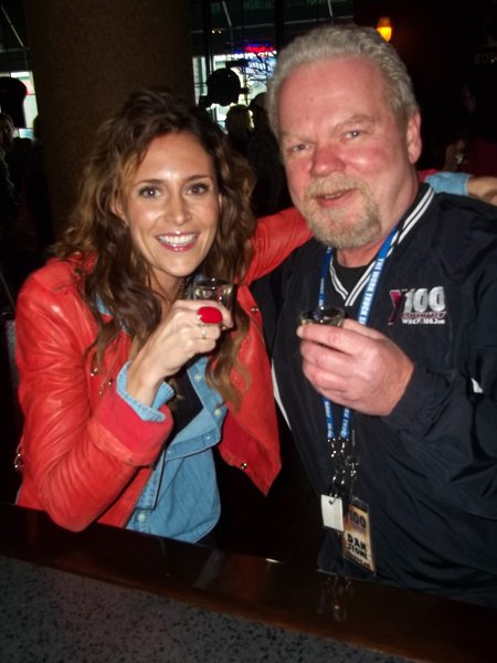 Dan Stone and Kelleigh Bannen belly up to the bar at Brett Favre's Steakhouse