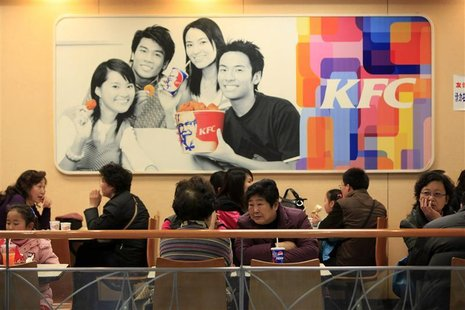People dine at a Kentucky Fried Chicken (KFC) outlet in Shanghai February 3, 2010. REUTERS/Aly Song