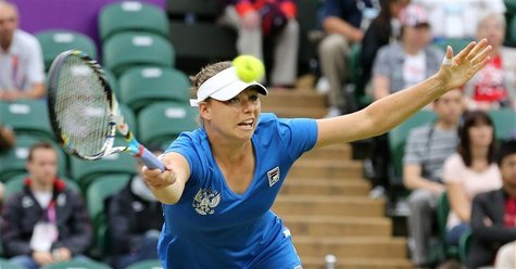 Russia's Vera Zvonareva reaches for a return to Serena Williams of the U.S. in their women's singles tennis match at the All England Lawn Te