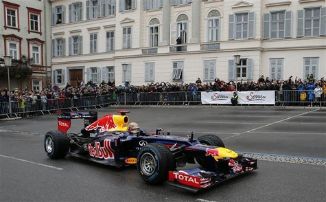 Red Bull three-time Formula One world champion Sebastian Vettel of Germany drives his racing car during a promotional event in the Austrian