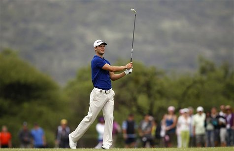 Martin Kaymer of Germany watches his shot on the third fairway during the 2012 Nedbank Golf Challenge in Sun City, December 2, 2012. REUTERS