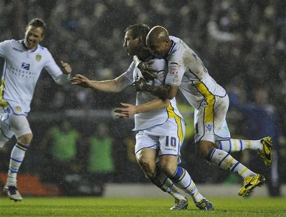 Leeds United's Luciano Becchio (C) celebrates his goal with El-Hadji Diouf (R) during their English League Cup quarter-final soccer match ag