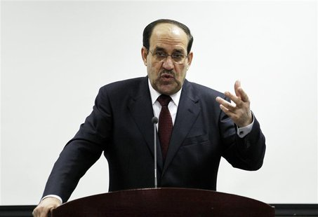 Iraq's Prime Minister Nuri al-Maliki speaks during the opening ceremony of the Defence University for Military Studies inside Baghdad's heav